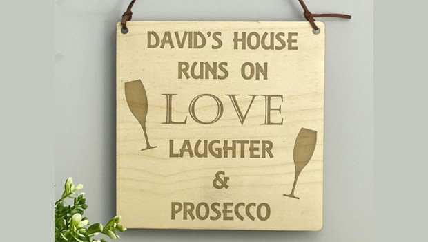 wooden prosecco sign